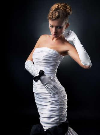 hair bow: Pretty fiancee blond woman in fashion wedding dress