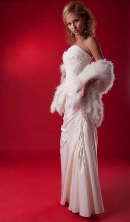 Bride fashion model in wedding dress on podium standing  photo