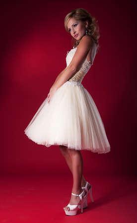 Fashion model blonde in wedding dress - studio shot  photo
