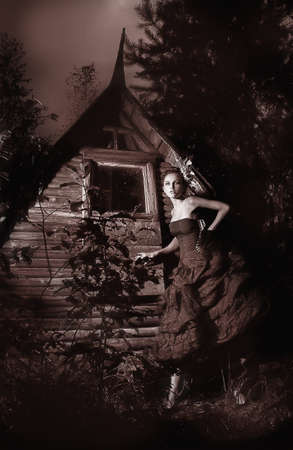 Night scenic - beautiful fairy walking along wooden hut black and white photo  photo