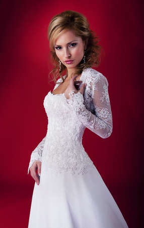 Sensual bride blonde in white bridal dress studio shot - series photo photo