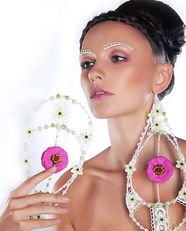 Portrait of amazing brunette supermodel with earrings photo