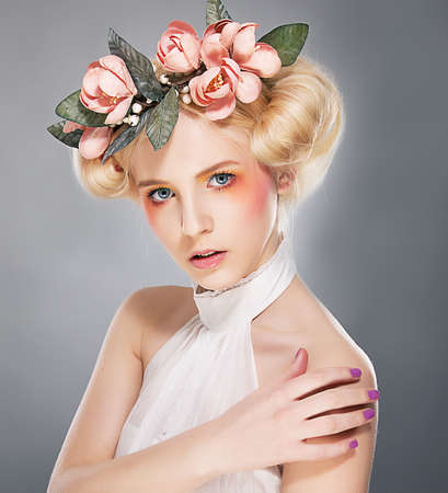 Luxurious supermodel lovely blonde in crown of flowers Stock Photo - 11927871