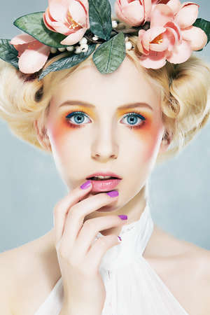 nymph: Beautiful blonde supermodel  in wreath of flowers closeup portrait Stock Photo