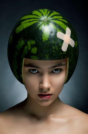 Young hair fashion model with ripe fresh watermelon as a helmet Фото со стока - 11928001