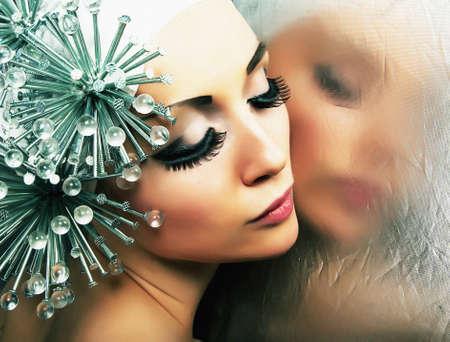 erotic fantasy: Beautiful fashion model reflects in mirror - studio shot