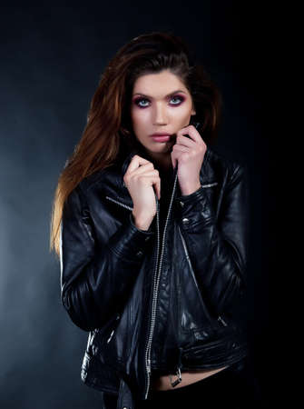 Pretty brunette in black leather jacket studio  shot Stock Photo - 11927925