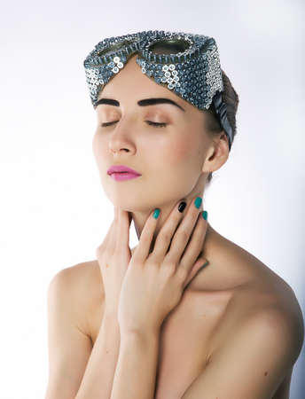 Pretty girl with closed eyes and unusual metallic spectacles Stock Photo - 11927896