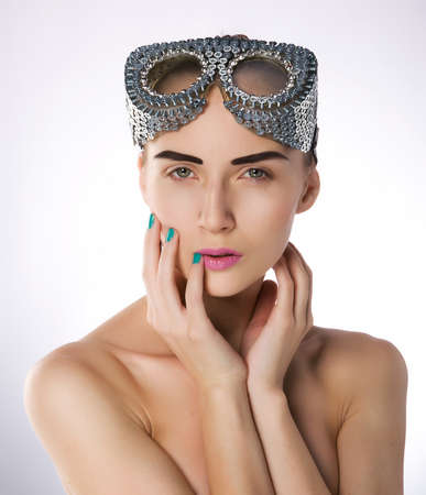 Beautiful young girl in unusual metallic glasses-series of photos photo