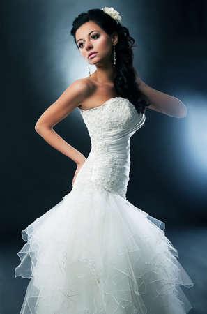 Sensual bride pretty brunette in bridal dress photo