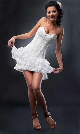 Cheerful sensual bride in short wedding dress dancing - series of photos photo