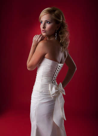 Nice blonde wedding model in white dress photo