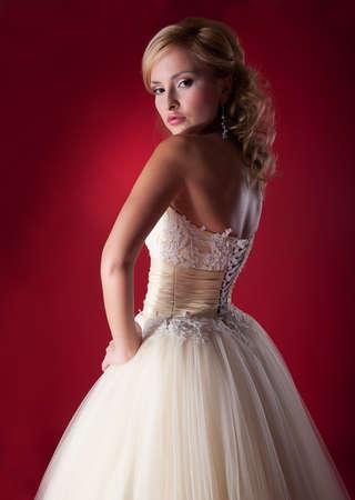 fiancee: Fiancee fashion model demonstrate white bridal dress - studio shot