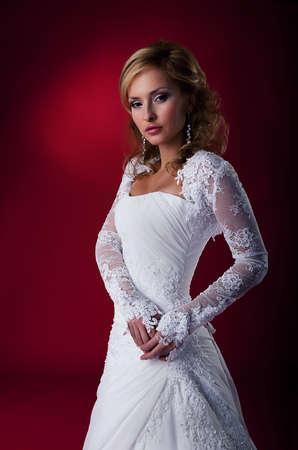 Fashion wedding model nice woman in bridal dress studio shot photo
