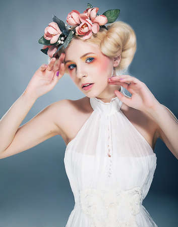 Beautiful blonde with colorful wreath in her head Stock Photo - 11927897