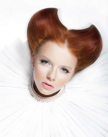 medieval woman: Glamorous young red haired model in white collar and bead of pearls  Stock Photo