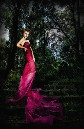 Nocturnal scenic - standing lovely lady on staircase among trees