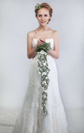 Lovely bride blond with bouquet of fresh tender flowers  photo