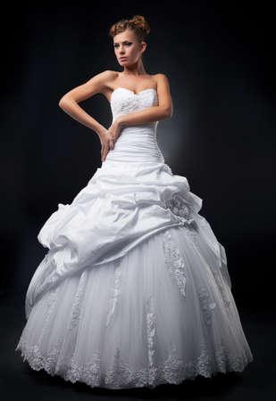 supermodel: Luxurious fiancee supermodel shows white wedding dress  Stock Photo
