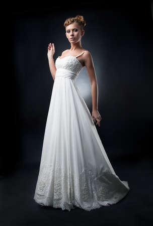 bridal dress: Romantic lovely bride fashion model demonstrates white wedding dress Stock Photo