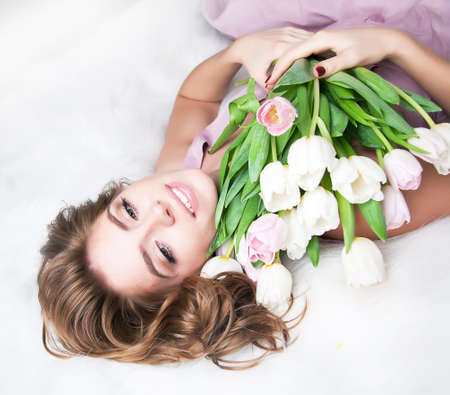 Dreaming lovely young girl with bouquet of flowers  photo