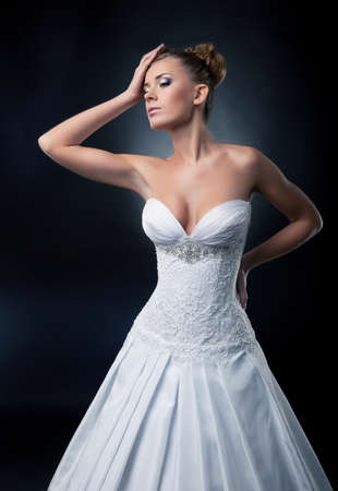 Tempting bride blonde fashion model posing in studio.  photo