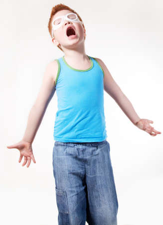 expressional: Red hair screaming concerned young boy isolated over white background