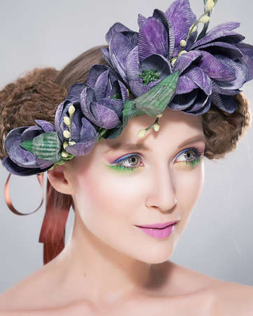 stagy: Beauty - young hairstyle model in colorful wreath of flowers closeup art portrait. Series of photos