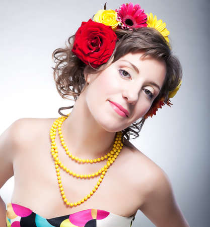 estival: Beauty female face - happy young fashionable girl with flowers. series of photos Stock Photo
