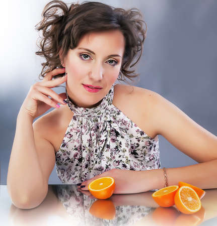 dishy: Young cute female with citrus - beautiful portrait. Series of photos Stock Photo