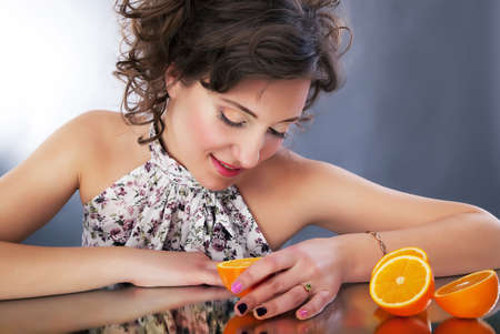 dishy: Lovely young girl with oranges. Studio shot, series of photos