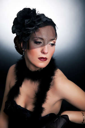 stagy: Victorian style - veiled young brunette female relaxing in dramatic pose. Stagy makeup