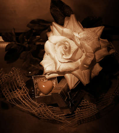 Retro still life - flower and symbol of heart as a gift for birthday. Grunge photo