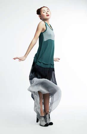 Fashion style - beautiful sexy asian woman in stylish modern dress. Studio shot Stock Photo - 12433165