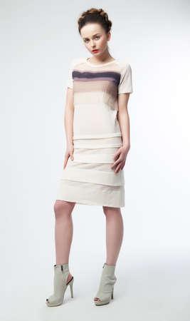 Beautiful fashionable woman brunette posing in studio - fashion style Stock Photo - 12433243