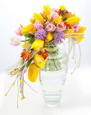 Colorful bouquet of spring flowers in vase photo