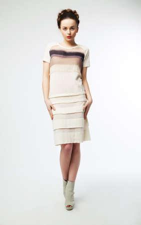 Elegant beautiful fashionable woman posing on podium - isolated on white background Stock Photo - 12433231