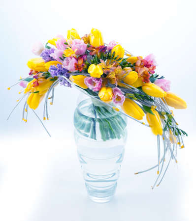 Fresh festive bouquet of flowers in vase on white background photo