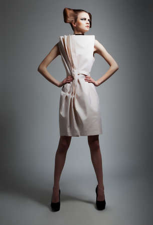 Fashion style - elegant lady with beautiful hairstyle isolated on grey background Stock Photo - 12433537