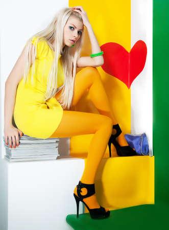 Beauty bright portrait of a fresh beautiful blonde fashion sexy mod photo
