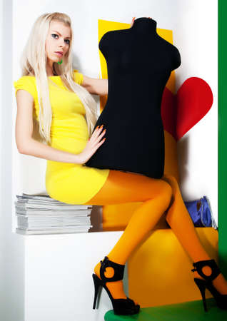 Art portrait of pretty young woman blonde hair with black mannequin - series of photos photo