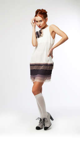 Fashionable beautiful young chinese lady fashion model in white dress on podium standing Stock Photo - 12433633
