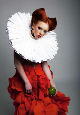 Romantic portrait of redhair woman with white jabot and red bright dress  Theatre photo