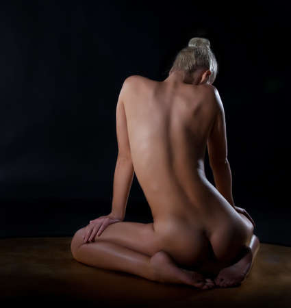 nude back: Nude sexy back and body of young female in soft light