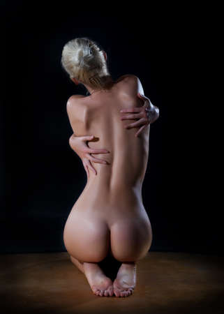 nude back: Female  beautiful nude woman back over black background