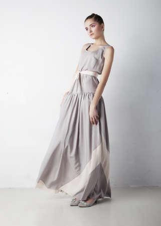 formal dress: Romantic young woman beauty wearing white fashion dress Stock Photo