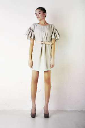 avantegarde: Sexy young woman wearing white short dress  Studio shot  Series of photos Stock Photo