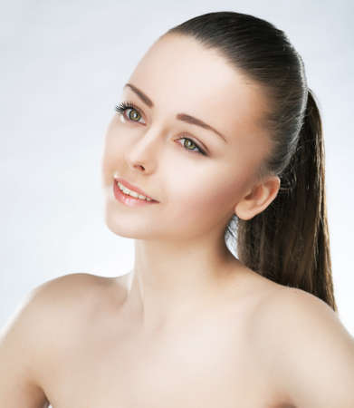 Beauty portrait of lovely girl fashion model with natural soft make-up and clean healthy skin photo