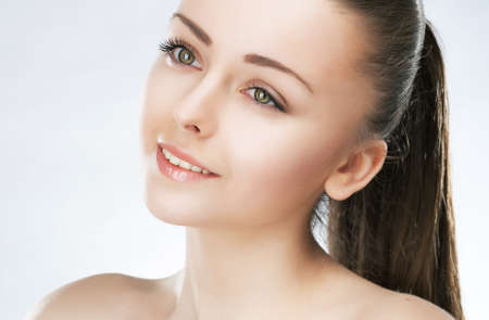 Close up portrait of sensual beautiful young woman fashion, purity complexion  Perfect clean skin  Studio shot Stock Photo - 12669381