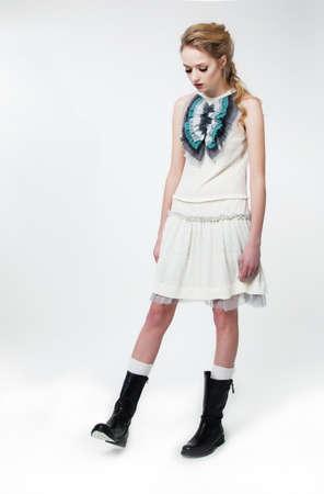 Fashion style - beautiful brunette slim girl in white dress posing on podium Stock Photo - 12669613